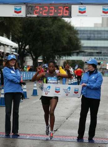 Merima Mohammed crosses the finish line to win the women's division of the Chevron Houston Marathon on Sunday. (James Nielsen/Chronicle)