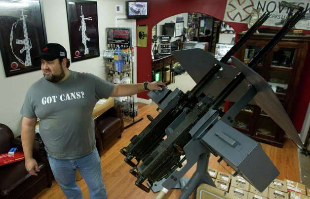 Cris Parsons, general manager, stands next to a Browning M-2 twin 50-caliber machine gun,It is for sale for $75,000 at Houston Armory Tuesday, Jan. 8, 2013, in Stafford. Houston Armory buys an sells, as well as manufactures weapons permitted and strictly controlled by the U.S. government, including machine guns, silencers and other specialty items. Photo: Brett Coomer, Houston Chronicle / © 2013 Houston Chronicle