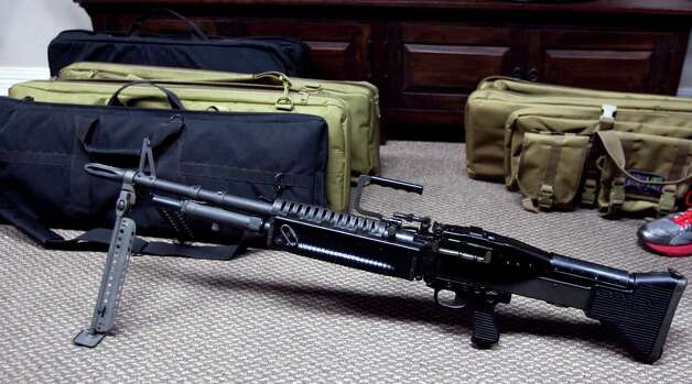 An M-60 rifle is shown at Houston Armory Tuesday, Jan. 8, 2013, in Stafford. Photo: Brett Coomer, Houston Chronicle / © 2013 Houston Chronicle