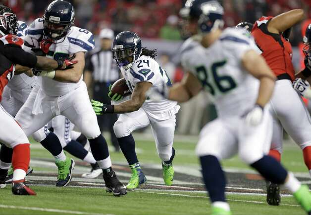 Seattle Seahawks' Marshawn Lynch runs during the first half of an NFC divisional playoff NFL football game against the Atlanta Falcons Sunday, Jan. 13, 2013, in Atlanta. (AP Photo/David Goldman) Photo: David Goldman, Associated Press / AP