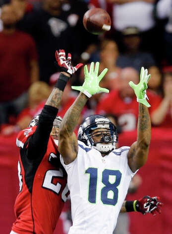 Seattle Seahawks wide receiver Sidney Rice (18) makes the catch as Atlanta Falcons free safety Thomas DeCoud (28) defends during the second half of an NFC divisional playoff NFL football game Sunday, Jan. 13, 2013, in Atlanta. (AP Photo/John Bazemore) Photo: John Bazemore, Associated Press / AP