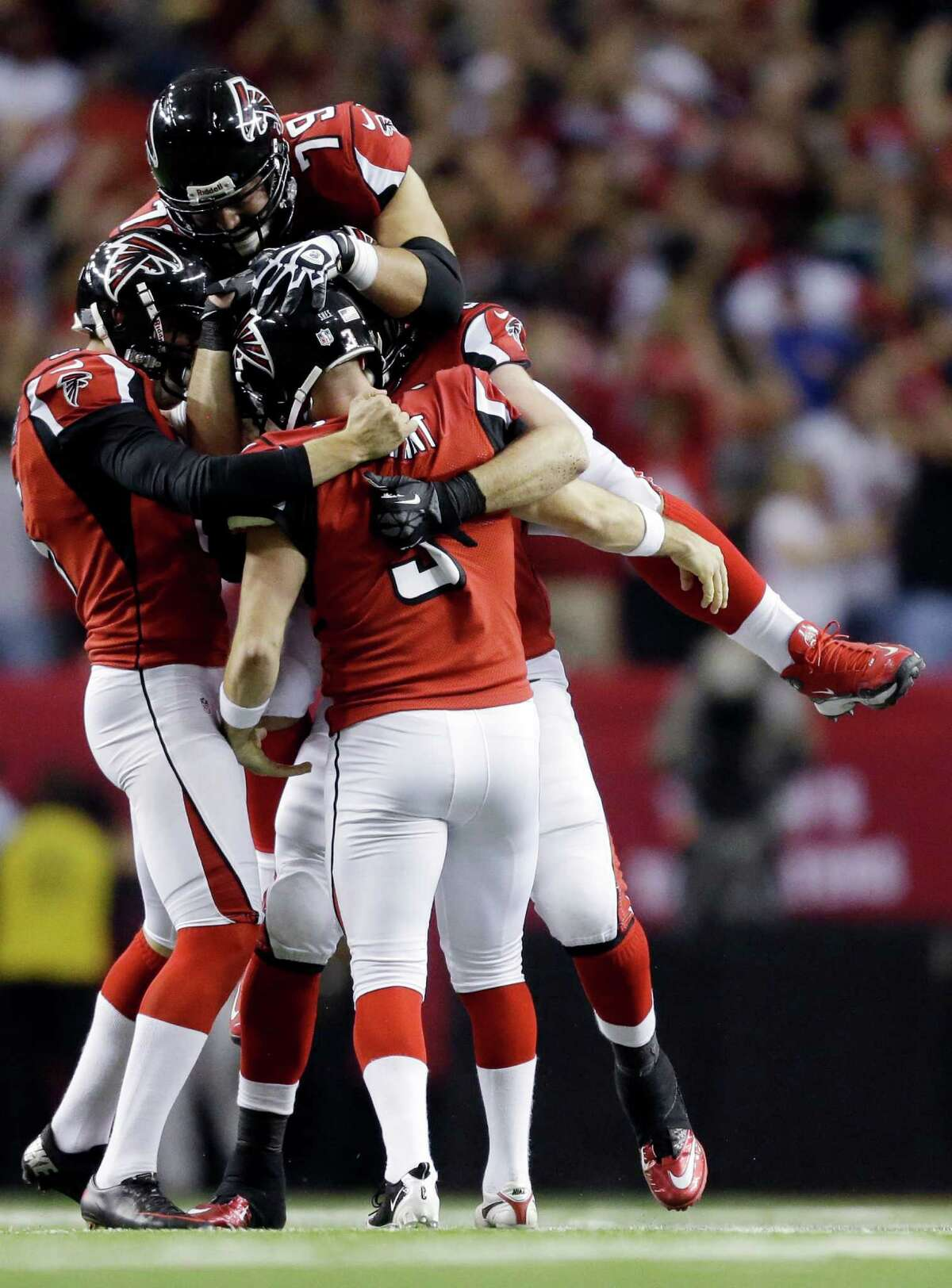 Atlanta Falcons kicker Matt Bryant (3) is congratulated by teammates after making the game-winning field goal during the second half of an NFC divisional playoff NFL football game against the Seattle Seahawks Sunday, Jan. 13, 2013, in Atlanta. The Falcons won 30-28. (AP Photo/David Goldman)
