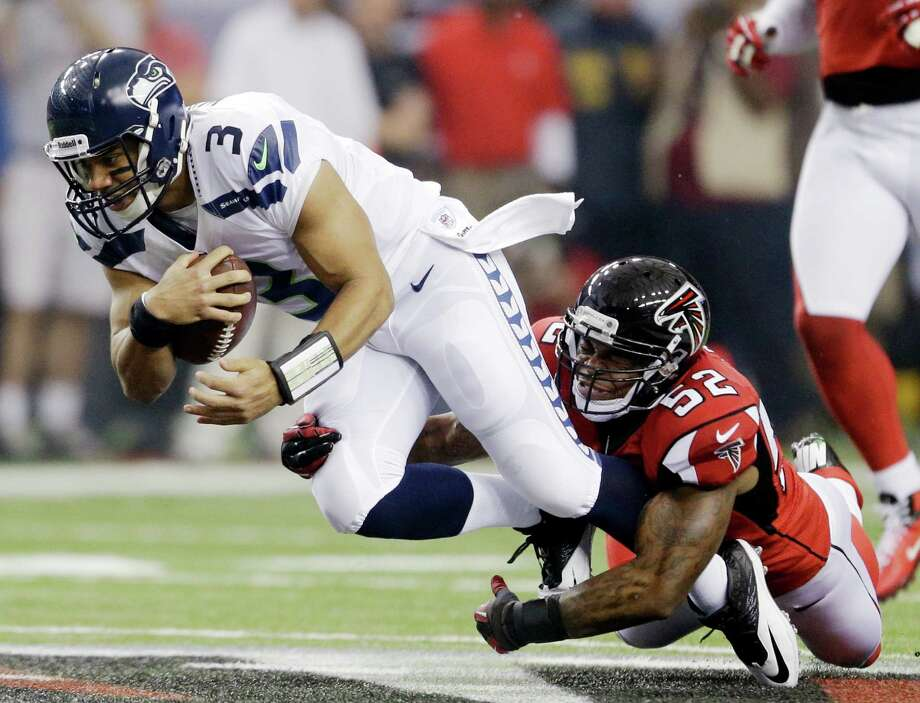 Seattle Seahawks quarterback Russell Wilson (3) is tackled by Atlanta Falcons' Akeem Dent (52) during the first half of an NFC divisional playoff NFL football game Sunday, Jan. 13, 2013, in Atlanta. (AP Photo/David Goldman) Photo: David Goldman, Associated Press / AP