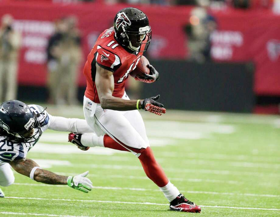 Atlanta Falcons' Julio Jones catches a pass during the first half of an NFC divisional playoff NFL football game against the Seattle Seahawks Sunday, Jan. 13, 2013, in Atlanta. (AP Photo/Dave Martin) Photo: Dave Martin, Associated Press / AP