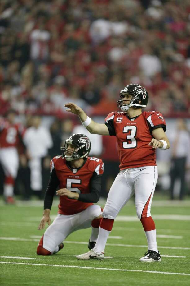 Atlanta Falcons kicker Matt Bryant (3) watches his field goal kick as Atlanta Falcons' Matt Bosher (5) looks on during the first half of an NFC divisional playoff NFL football game against the Seattle Seahawks Sunday, Jan. 13, 2013, in Atlanta. (AP Photo/David Goldman) Photo: David Goldman, Associated Press / AP