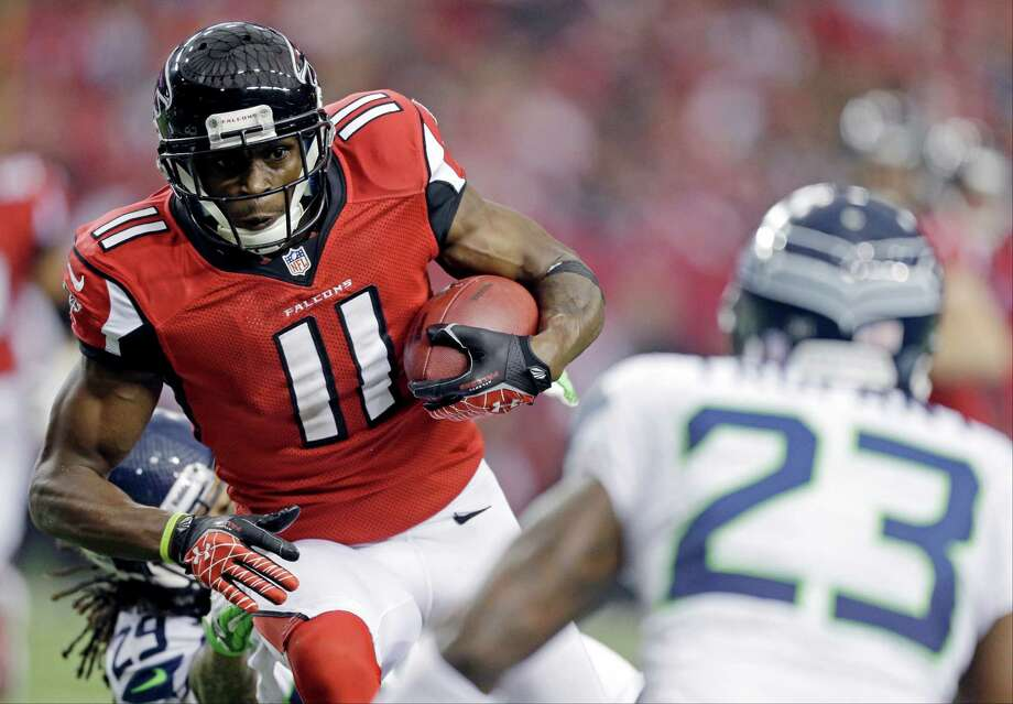 Atlanta Falcons wide receiver Julio Jones (11) works against Seattle Seahawks cornerback Marcus Trufant (23) during the first half of an NFC divisional playoff NFL football game Sunday, Jan. 13, 2013, in Atlanta. (AP Photo/David Goldman) Photo: David Goldman, Associated Press / AP