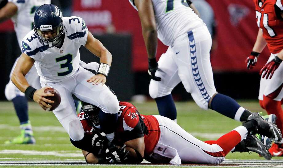 Seattle Seahawks quarterback Russell Wilson (3) is sacked by Atlanta Falcons defensive end Vance Walker (99) during the second half of an NFC divisional playoff NFL football game Sunday, Jan. 13, 2013, in Atlanta. (AP Photo/John Bazemore) Photo: John Bazemore, Associated Press / AP