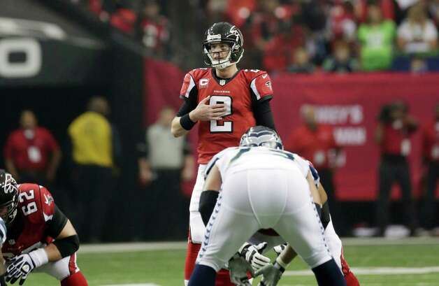 Atlanta Falcons' Matt Ryan calls a play during the first half of an NFC divisional playoff NFL football game against the Seattle Seahawks Sunday, Jan. 13, 2013, in Atlanta. (AP Photo/Dave Martin) Photo: Dave Martin, Associated Press / AP