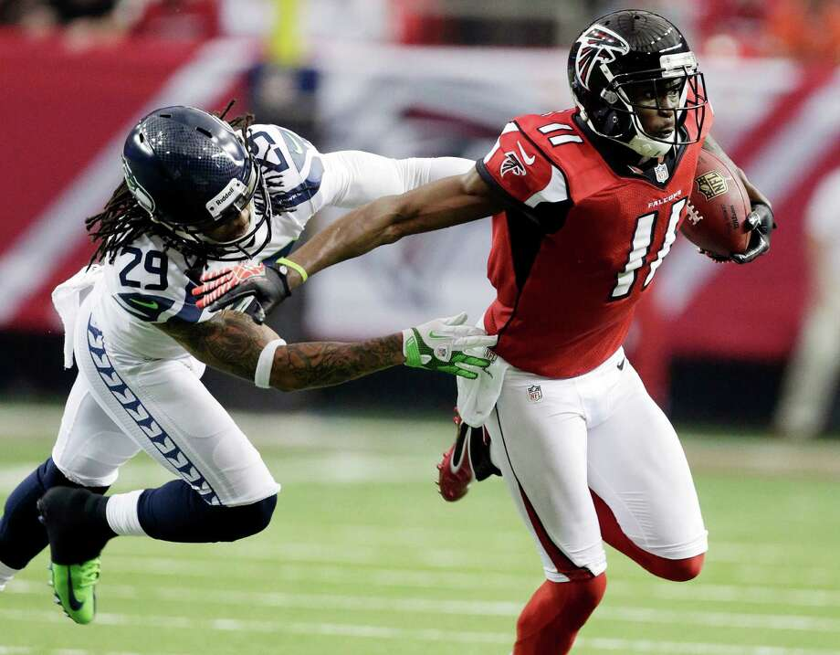 Atlanta Falcons wide receiver Julio Jones (11) tries to get away from Seattle Seahawks' Earl Thomas (29) during the first half of an NFC divisional playoff NFL football game Sunday, Jan. 13, 2013, in Atlanta. (AP Photo/Dave Martin) Photo: Dave Martin, Associated Press / AP