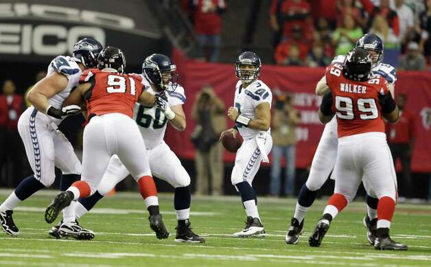 Seattle Seahawks' Russell Wilson drops back during the first half of an NFC divisional playoff NFL football game against the Atlanta Falcons Sunday, Jan. 13, 2013, in Atlanta. (AP Photo/David Goldman) Photo: David Goldman, Associated Press / AP