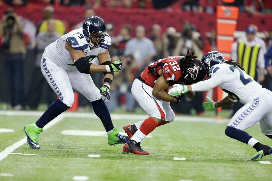 Atlanta Falcons' Jacquizz Rodgers (32) runs during the first half of an NFC divisional playoff NFL football game against the Seattle Seahawks Sunday, Jan. 13, 2013, in Atlanta. (AP Photo/David Goldman) Photo: David Goldman, Associated Press / AP