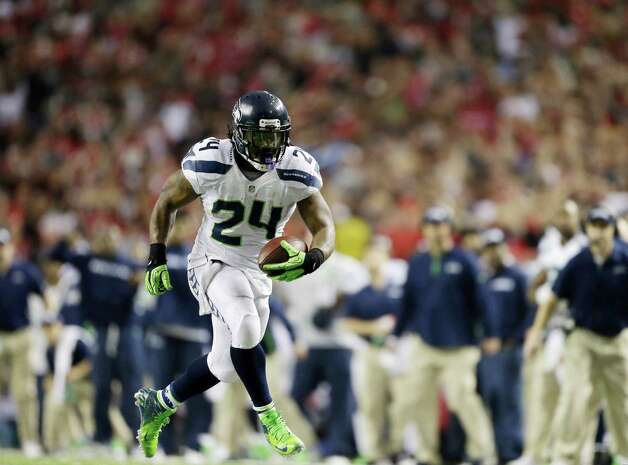 Seattle Seahawks' Marshawn Lynch runs during the second half of an NFC divisional playoff NFL football game against the Atlanta Falcons Sunday, Jan. 13, 2013, in Atlanta. (AP Photo/David Goldman) Photo: David Goldman, Associated Press / AP