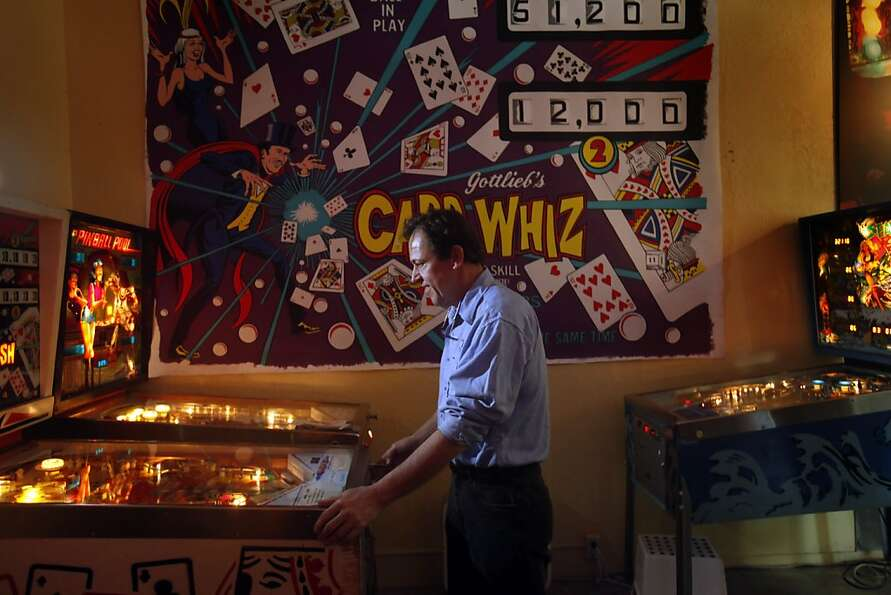 Pinball museum executive director Michael Schiess demonstrates the appeal of the Card Whiz game.