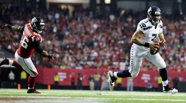 Seattle Seahawks quarterback Russell Wilson (3) runs the ball into the end zone as Atlanta Falcons outside linebacker Sean Weatherspoon (56) looks on during the second half of an NFC divisional playoff NFL football game Sunday, Jan. 13, 2013, in Atlanta. (AP Photo/David Goldman) Photo: David Goldman, Associated Press / AP