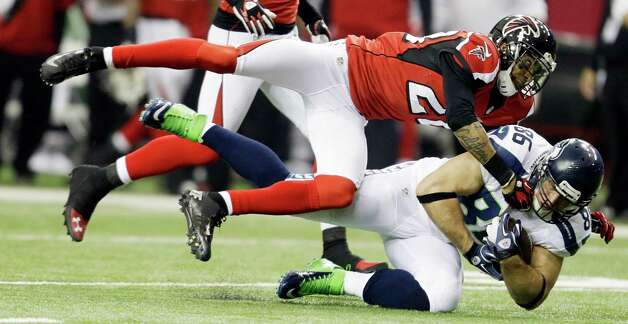 Seattle Seahawks tight end Zach Miller (86) makes the catch against Atlanta Falcons free safety Thomas DeCoud (28) during the first half of an NFC divisional playoff NFL football game Sunday, Jan. 13, 2013, in Atlanta. (AP Photo/David Goldman) Photo: David Goldman, Associated Press / AP