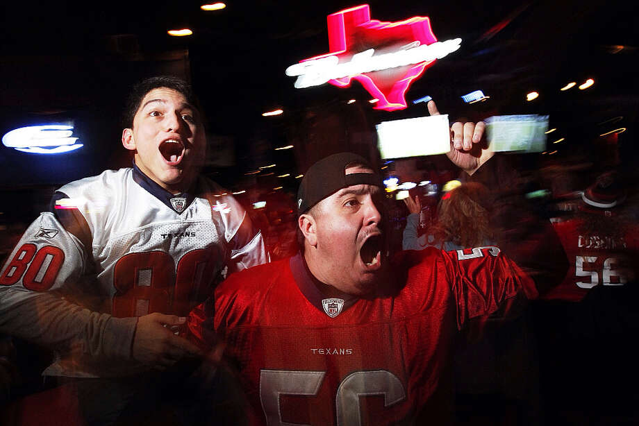 Carlo Medellin, right, and Cody Vela, celebrate Danielle Manning's return on the opening kickoff at SRO Sports Bar and Cafe.