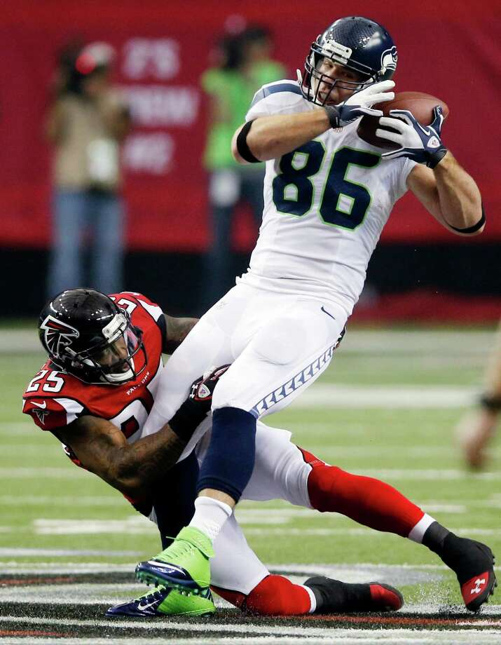 Seattle Seahawks tight end Zach Miller catches a pass with Atlanta Falcons' William Moore (25) defending during the first half of an NFC divisional playoff NFL football game Sunday, Jan. 13, 2013, in Atlanta. (AP Photo/John Bazemore) Photo: John Bazemore, Associated Press / AP
