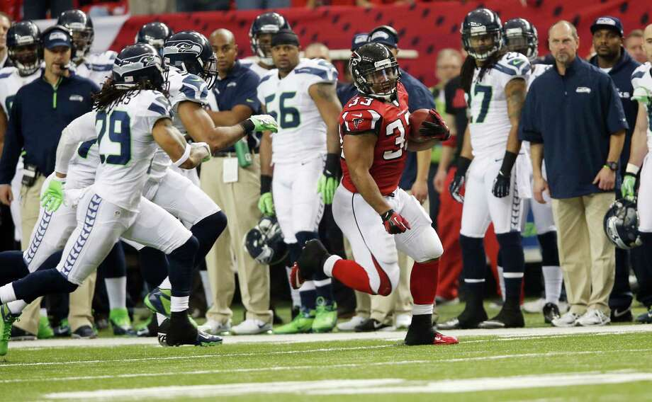 Atlanta Falcons' Michael Turner runs during the first half of an NFC divisional playoff NFL football game against the Seattle Seahawks Sunday, Jan. 13, 2013, in Atlanta. (AP Photo/John Bazemore) Photo: John Bazemore, Associated Press / AP