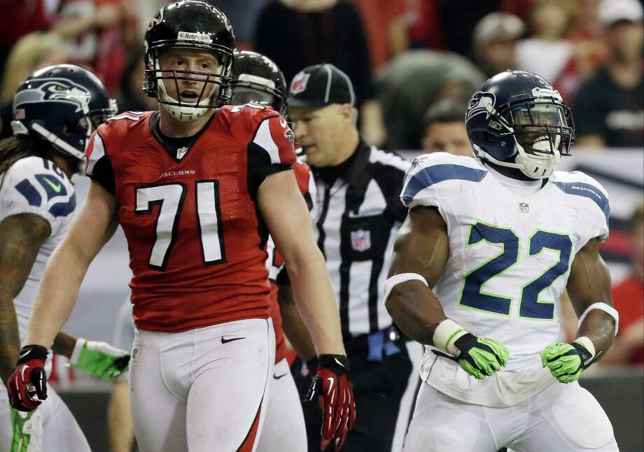 Seattle Seahawks running back Robert Turbin (22) reacts to a run as Atlanta Falcons defensive end Kroy Biermann (71) looks on during the second half of an NFC divisional playoff NFL football game Sunday, Jan. 13, 2013, in Atlanta. (AP Photo/David Goldman) Photo: David Goldman, Associated Press / AP