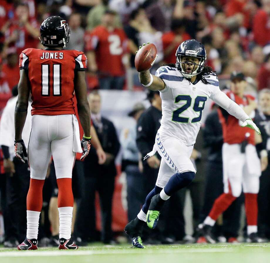 Seattle Seahawks free safety Earl Thomas (29) reacts to a turnover as Atlanta Falcons wide receiver Julio Jones (11) looks on during the second half of an NFC divisional playoff NFL football game Sunday, Jan. 13, 2013, in Atlanta. (AP Photo/David Goldman) Photo: David Goldman, Associated Press / AP