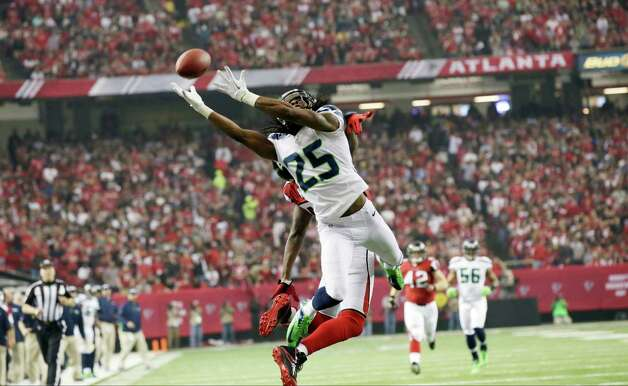 Seattle Seahawks cornerback Richard Sherman (25) goes up for a ball during the first half of an NFC divisional playoff NFL football game against the Atlanta Falcons Sunday, Jan. 13, 2013, in Atlanta. (AP Photo/Dave Martin) Photo: Dave Martin, Associated Press / AP