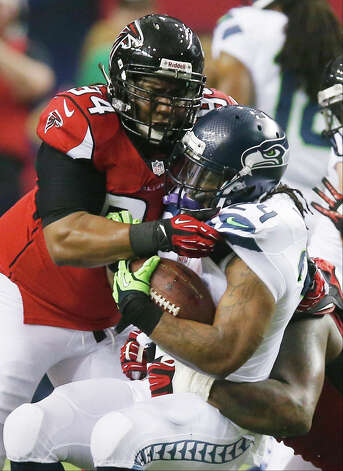 Seattle Seahawks running back Marshawn Lynch (24) is hit by Atlanta Falcons defensive tackle Peria Jerry (94) and Atlanta Falcons defensive tackle Jonathan Babineaux, right, during the first half of an NFC divisional playoff NFL football game Sunday, Jan. 13, 2013, in Atlanta. (AP Photo/John Bazemore) Photo: John Bazemore, Associated Press / AP