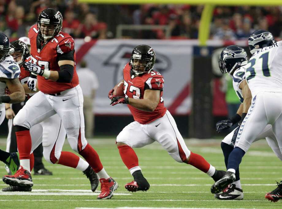 Atlanta Falcons' Michael Turner runs during the first half of an NFC divisional playoff NFL football game against the Seattle Seahawks Sunday, Jan. 13, 2013, in Atlanta. (AP Photo/Dave Martin) Photo: Dave Martin, Associated Press / AP