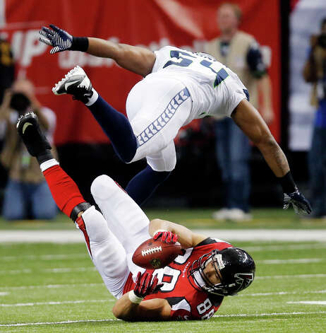 Atlanta Falcons tight end Tony Gonzalez (88) makes the catch under Seattle Seahawks middle linebacker Bobby Wagner (54) during the second half of an NFC divisional playoff NFL football game Sunday, Jan. 13, 2013, in Atlanta. (AP Photo/John Bazemore) Photo: John Bazemore, Associated Press / AP