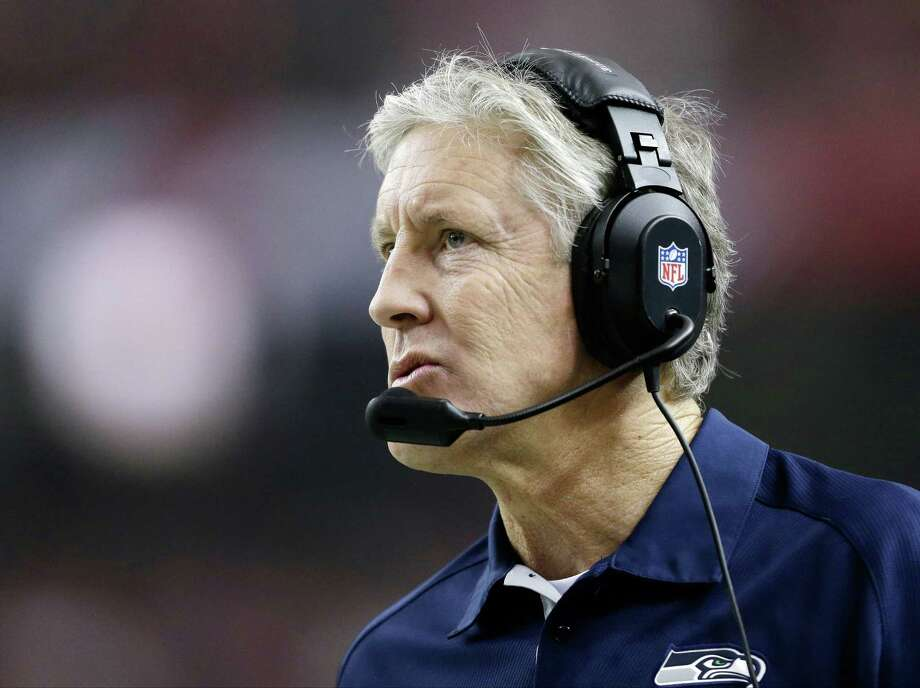 Seattle Seahawks head coach Pete Carroll watches play during the first half of an NFC divisional playoff NFL football game against the Atlanta Falcons Sunday, Jan. 13, 2013, in Atlanta. (AP Photo/David Goldman) Photo: David Goldman, Associated Press / AP