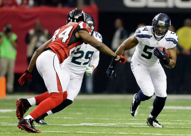 Seattle Seahawks middle linebacker Bobby Wagner (54) runs an interception back in front of Atlanta Falcons' Roddy White (84) during the first half of an NFC divisional playoff NFL football game Sunday, Jan. 13, 2013, in Atlanta. (AP Photo/David Goldman) Photo: David Goldman, Associated Press / AP