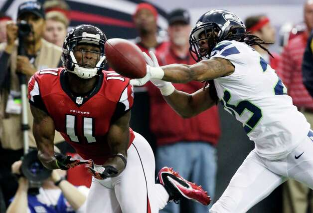 Atlanta Falcons wide receiver Julio Jones (11) misses a catch as Seattle Seahawks cornerback Richard Sherman (25) defends during the first half of an NFC divisional playoff NFL football game Sunday, Jan. 13, 2013, in Atlanta. (AP Photo/Dave Martin) Photo: Dave Martin, Associated Press / AP