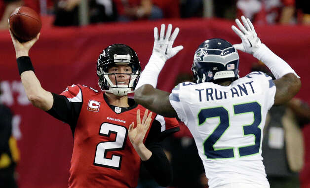 Atlanta Falcons quarterback Matt Ryan (2) throws against Seattle Seahawks cornerback Marcus Trufant (23) during the second half of an NFC divisional playoff NFL football game Sunday, Jan. 13, 2013, in Atlanta. (AP Photo/Dave Martin) Photo: Dave Martin, Associated Press / AP