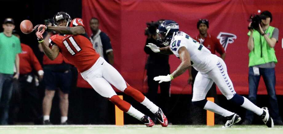 Atlanta Falcons wide receiver Julio Jones (11) works against Seattle Seahawks DeShawn Shead (35) during the second half of an NFC divisional playoff NFL football game Sunday, Jan. 13, 2013, in Atlanta. (AP Photo/David Goldman) Photo: David Goldman, Associated Press / AP