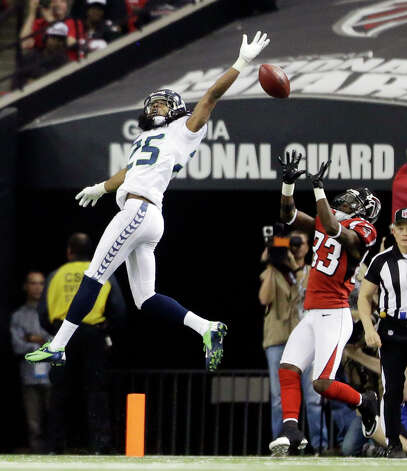 Seattle Seahawks cornerback Richard Sherman (25) breaks up a pass intended Atlanta Falcons wide receiver Harry Douglas (83) during the second half of an NFC divisional playoff NFL football game Sunday, Jan. 13, 2013, in Atlanta. (AP Photo/David Goldman) Photo: David Goldman, Associated Press / AP