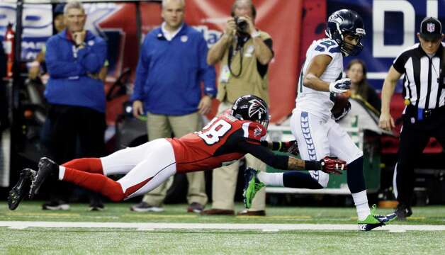 Seattle Seahawks wide receiver Golden Tate (81) gets past Atlanta Falcons free safety Thomas DeCoud (28) for a touchdown reception during the second half of an NFC divisional playoff NFL football game Sunday, Jan. 13, 2013, in Atlanta. (AP Photo/David Goldman) Photo: David Goldman, Associated Press / AP