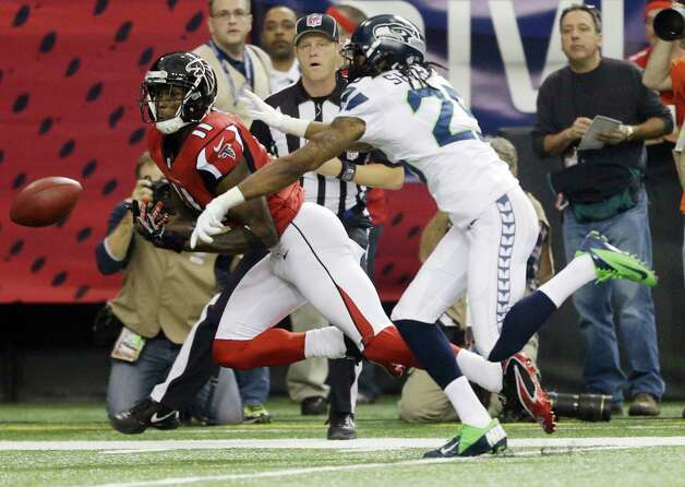 Atlanta Falcons' Julio Jones tries to catch a pass during the first half of an NFC divisional playoff NFL football game against the Seattle Seahawks Sunday, Jan. 13, 2013, in Atlanta. (AP Photo/David Goldman) Photo: David Goldman, Associated Press / AP