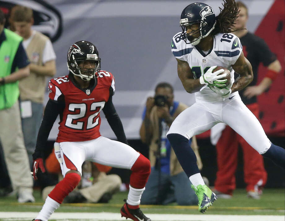 Seattle Seahawks wide receiver Sidney Rice (18) works against Atlanta Falcons cornerback Asante Samuel (22) during the first half of an NFC divisional playoff NFL football game Sunday, Jan. 13, 2013, in Atlanta. (AP Photo/John Bazemore) Photo: John Bazemore, Associated Press / AP