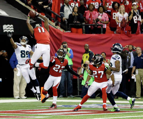 Atlanta Falcons' Julio Jones (11) intercepts a pass on a Seattle Seahawks quarterback Russell Wilson Hail-Mary pass during the second half of an NFC divisional playoff NFL football game Sunday, Jan. 13, 2013, in Atlanta. The Falcons won 30-28. (AP Photo/David Goldman) Photo: David Goldman, Associated Press / AP