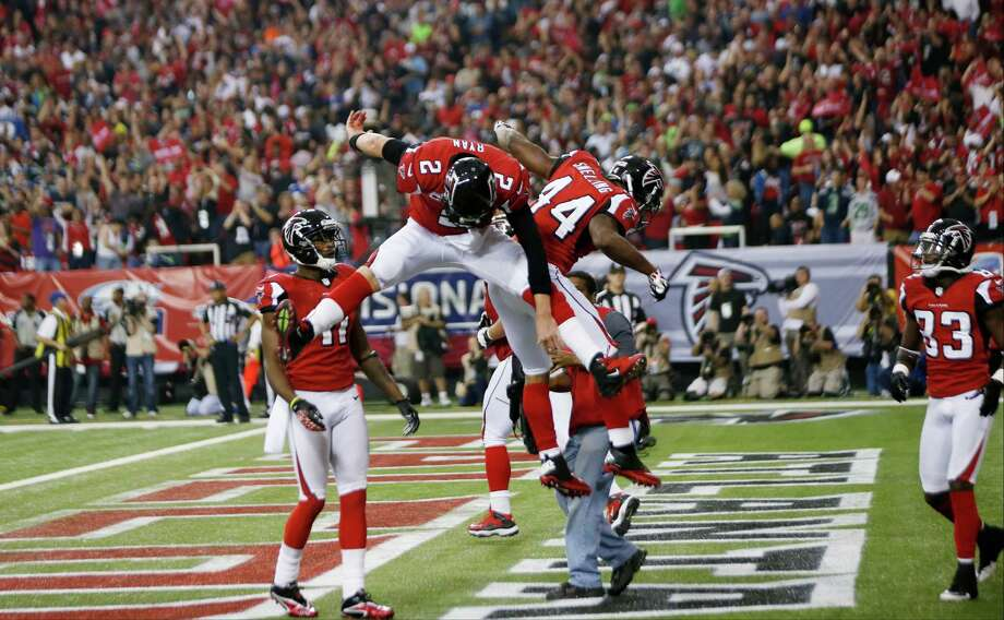 Atlanta Falcons fullback Jason Snelling (44) celebrates his touchdown run with quarterback Matt Ryan (2) during the second half of an NFC divisional playoff NFL football game against the Seattle Seahawks Sunday, Jan. 13, 2013, in Atlanta. (AP Photo/John Bazemore) Photo: John Bazemore, Associated Press / AP