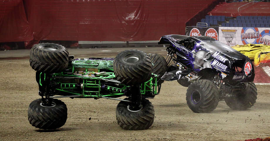 Grave Digger takes a spill during a second round race against Mohawk Warrior at the Advance Auto Parts Monster Jam in the Alamodome, Sunday, Jan. 13, 2013. Photo: Jerry Lara, San Antonio Express-News / © 2013 San Antonio Express-News