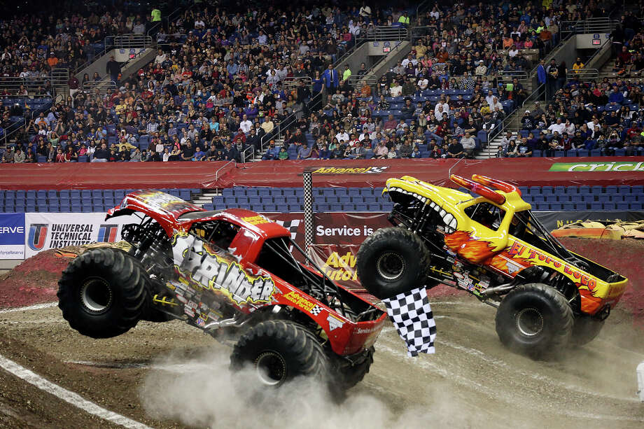 Grinder and El Toro Loco battle it out in a second round race during the Advance Auto Parts Monster Jam at the Alamodome, Sunday, Jan. 13, 2013. Photo: Jerry Lara, San Antonio Express-News / © 2013 San Antonio Express-News