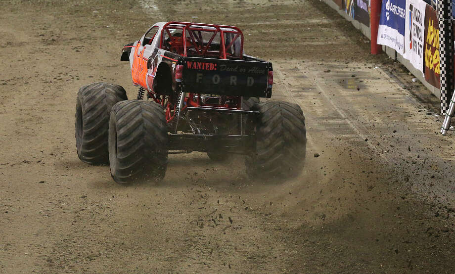 Outlaw heads to the last turn during first round races of the Advance Auto Parts Monster Jam at the Alamodome, Sunday, Jan. 13, 2013. Photo: Jerry Lara, San Antonio Express-News / © 2013 San Antonio Express-News