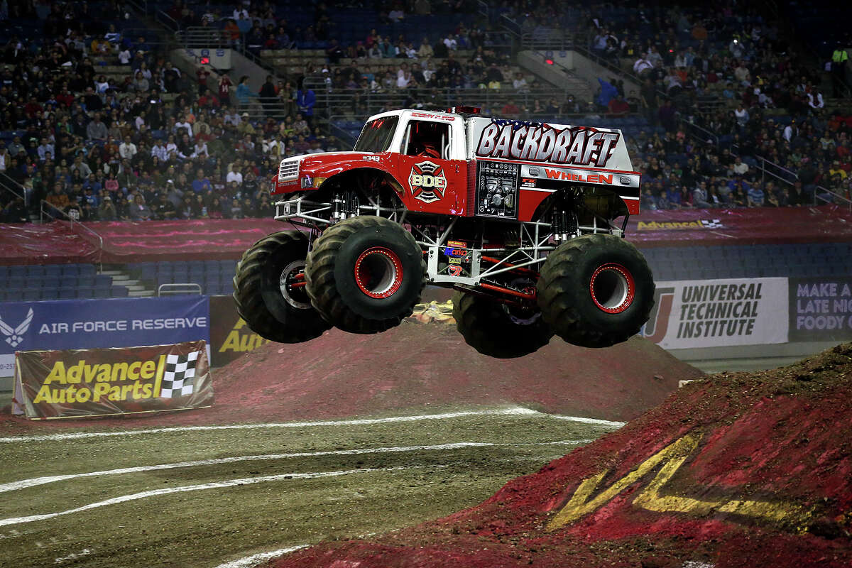 Backdraft competes in first round races of the Advance Auto Parts Monster Jam at the Alamodome, Sunday, Jan. 13, 2013.