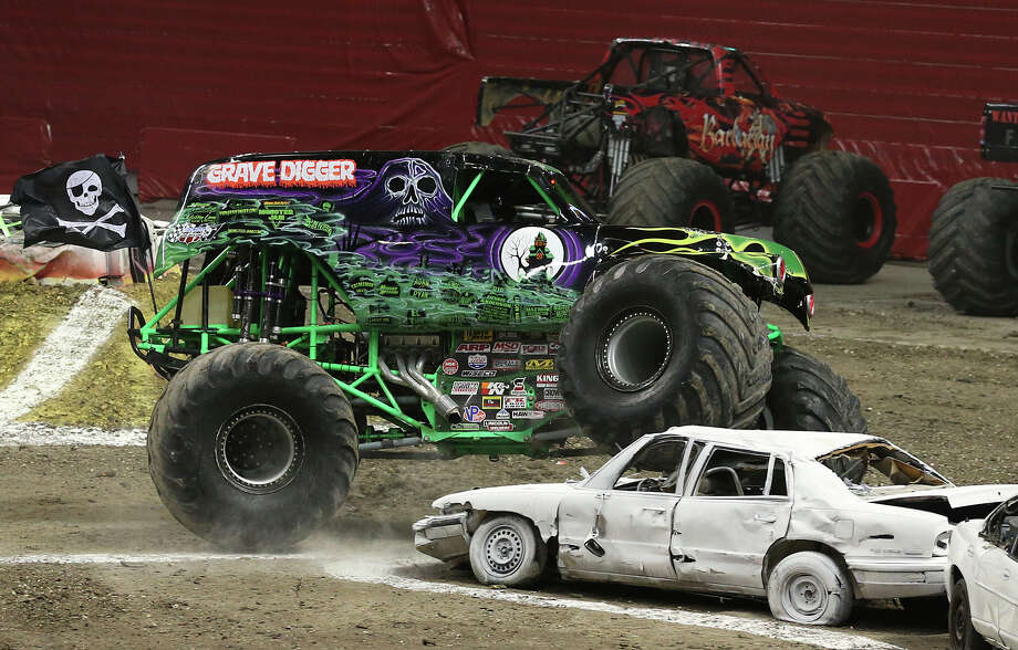 Grave Digger cuts a corner short during first round faces of Advance Auto Parts Monster Jam at the Alamodome, Sunday, Jan. 13, 2013. Photo: Jerry Lara, San Antonio Express-News / © 2013 San Antonio Express-News