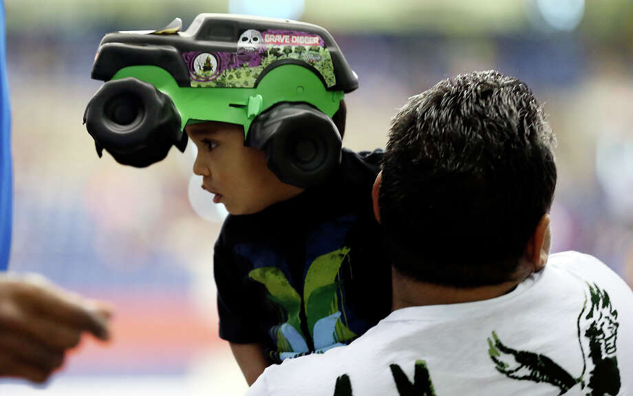 Ethan Guevara, 18 months, sports a popular item as fans flock to the Alamodome to watch the Advance Auto Parts Monster Jam, Sunday, Jan. 13, 2013.  Photo: Jerry Lara, San Antonio Express-News / © 2013 San Antonio Express-News
