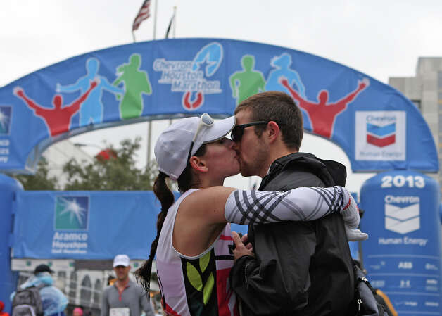 Ryan Smith, right, kisses his fiance after proposing to her. Photo: James Nielsen, Chronicle / © Houston Chronicle 2013
