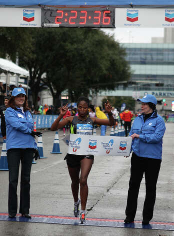 Merima Mohammed crosses the finish line to win the women's division of the Chevron Houston Marathon. Photo: James Nielsen, Chronicle / © Houston Chronicle 2013