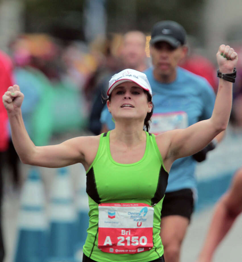 Briana Stark nears the finish line. Photo: James Nielsen, Chronicle / © Houston Chronicle 2013