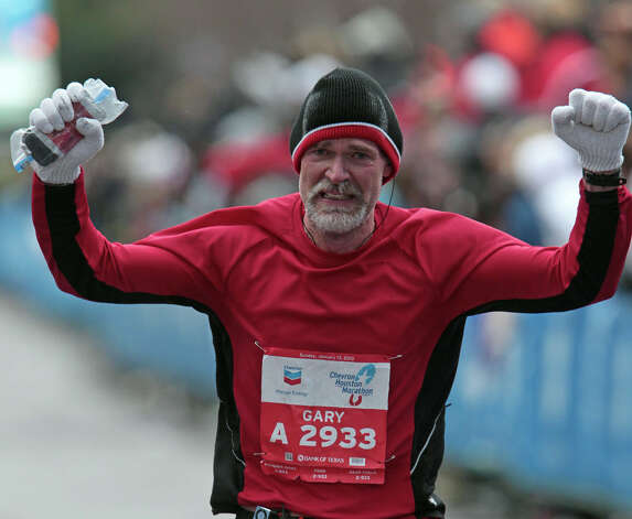 Gary Moroney nears the finish line. Photo: James Nielsen, Chronicle / © Houston Chronicle 2013