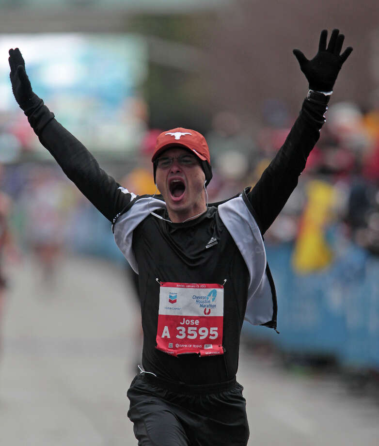 Jose Lomonaco reacts as he crosses the finish line. Photo: James Nielsen, Chronicle / © Houston Chronicle 2013